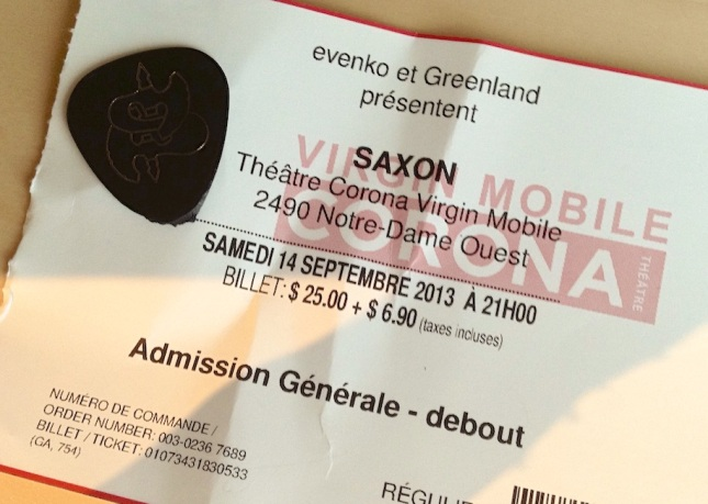 Ticket with Saxon guitar pick